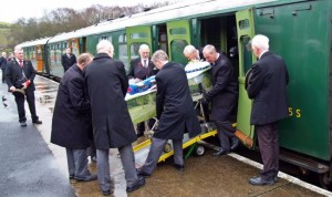 Mike volunteered on the Swanage Railway for 44 years and is pictured here being taken to his funeral in a carriage he had restored himself.