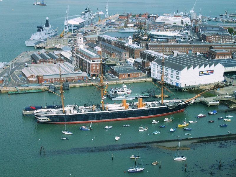 HMS Warrior with HMS Dragon and one of the aircraft carriers being mothballed