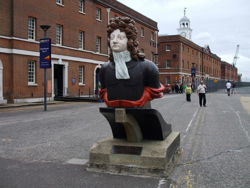 Figurehead of HMS Benbow, with some of the fine Georgian naval buildings beyond