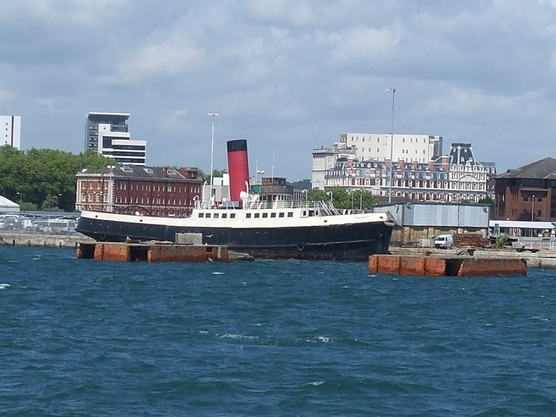 Preserved tug Calshot, the old Southampton Terminus station building in the background